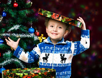 Boy on the background of the Christmas tree Royalty Free Stock Photography
