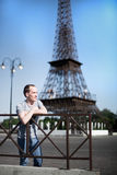 Boy on a background copy of the Eiffel Tower Stock Image