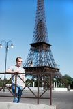 Boy on a background copy of the Eiffel Tower Stock Images