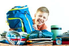 Boy on the background of his things with a bag stock images