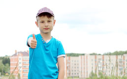 boy on the background of the house Royalty Free Stock Photography