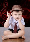 A boy on a background with musical notes royalty free stock image