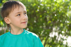 Boy is on the background of nature Royalty Free Stock Image