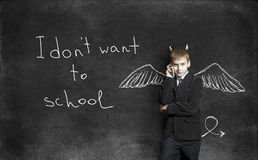 The boy on the background of the school boards with chalk drawin Royalty Free Stock Images