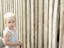 Boy on  background of wooden fence Royalty Free Stock Photography