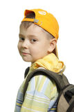 Boy with backpack. Looking over shoulder isolated Royalty Free Stock Photos