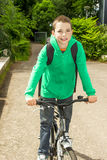 Boy with backpack on a bicycle. Young school boy with backpack on a bicycle Royalty Free Stock Photography
