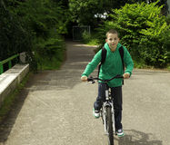 Boy with backpack on a bicycle Stock Photo