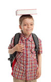 Boy with a backpack and the book on a head Royalty Free Stock Image