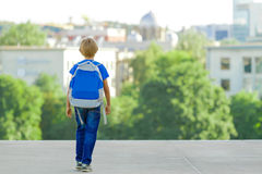 Boy with backpack on city street. Back to school, education, people, travel, leisure concept. Boy with backpack on city street. Back to school, education, people stock photo