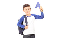 Boy with backpack holding the letter a Stock Image
