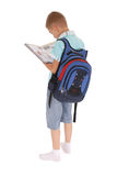 Boy with a backpack holds the book Stock Image