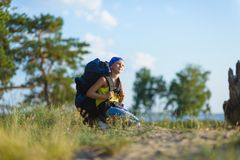 Boy with backpack looks into the distance. Adventure, travel, tourism concept.  royalty free stock images