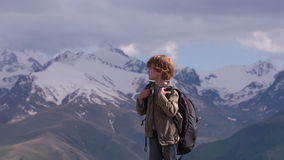 Boy with a Backpack in the Mountains stock video