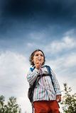 Boy is playing with soap bubbles. Royalty Free Stock Images