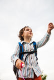 A boy is playing with soap bubbles. Stock Photo