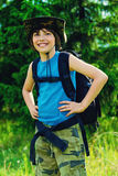 Boy with backpack. Ten year old boy go hiking with backpack and binocular. Exploring the world. Summer holidays. Outdoor activities royalty free stock photography