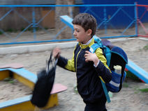 Boy  with backpack walking blurred motion image Stock Photo