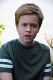Boy  in bad mood. Portrait of an angry teenager boy Stock Photo