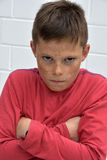 Boy  in bad mood. Portrait of an  angry teenager boy Royalty Free Stock Photo