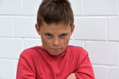 Boy  in bad mood. Portrait of an  angry teenager boy Royalty Free Stock Photography