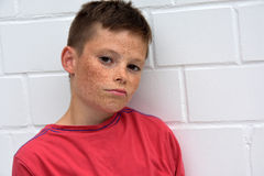 Boy  in bad mood. Portrait of a bored  teenager boy making a deadpan Royalty Free Stock Photo