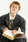 Boy in Baggy Suit Reading Stock Photography