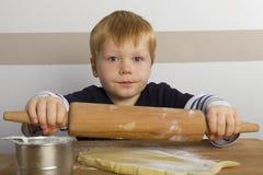 Boy baking Stock Photography