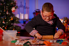 Boy baking Christmas cookies Royalty Free Stock Image