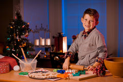 Boy baking Christmas cookies Royalty Free Stock Images