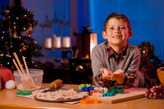 Boy baking Christmas cookies Royalty Free Stock Photos