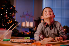 Boy baking Christmas cookies Royalty Free Stock Photo