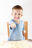 Boy baking cookies Royalty Free Stock Photos