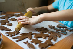 Boy baking cookies Stock Image