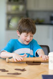 Boy baking cookies Royalty Free Stock Images