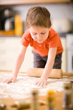 Boy baking cookies Stock Photos