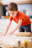 Boy baking cookies Royalty Free Stock Photography