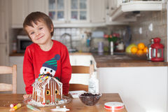 Boy, baking ginger cookies for Christmas Stock Image