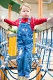 Boy on a balance beam Stock Photo