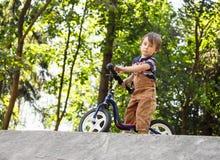 Boy with a balance bike Stock Image