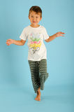 Boy in balance on one foot Royalty Free Stock Photo