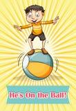 Boy balancing on the ball Royalty Free Stock Image