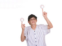 Boy balancing baseballs Royalty Free Stock Photography