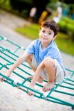 Boy balancing on rope activity Royalty Free Stock Photo