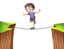 Boy balancing on the rope Royalty Free Stock Photography