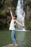 Boy balancing at waterfall Stock Photo