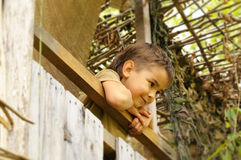 Boy on the balcony looking at someone Royalty Free Stock Photography