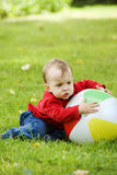 Boy with the ball. Little boy with big colorful ball outdoors royalty free stock images
