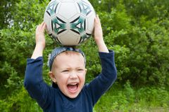 Boy & ball Stock Images