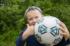 Boy & ball Stock Image